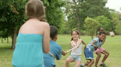 stock-footage-children-and-recreation-group-of-happy-multiethnic-school-kids-playing-tug-of-war-in-city-park